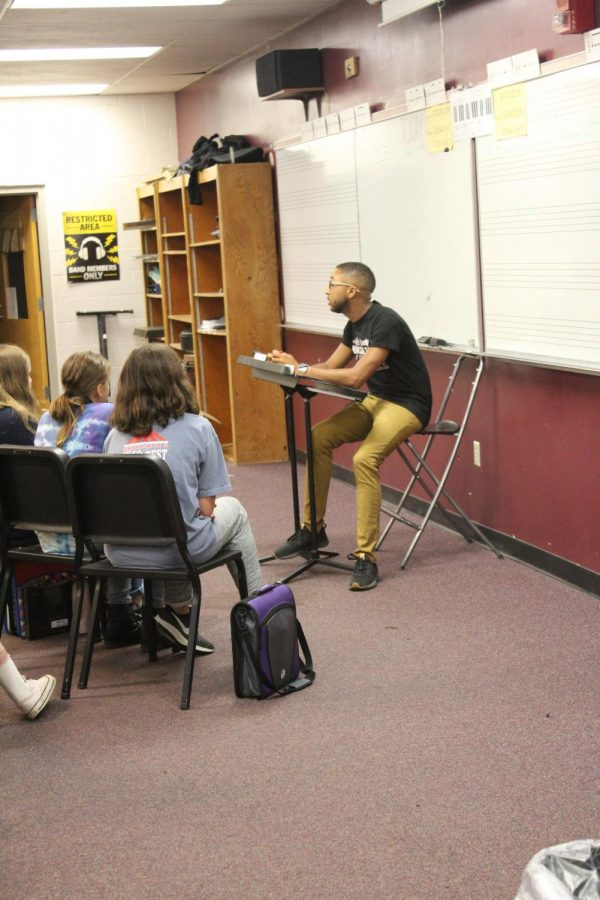 Mr. Stone works with the middle school to help develop music reading/ playing skills.