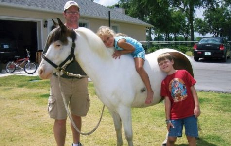 My brother, dad and I loving on our pony, Pete, while living in Florida!