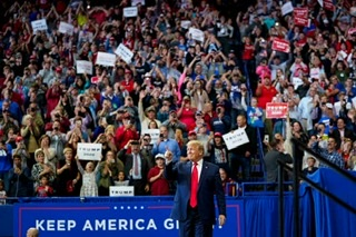 President Trump walking onto the stage in Lexington Kentucky (at the rally)