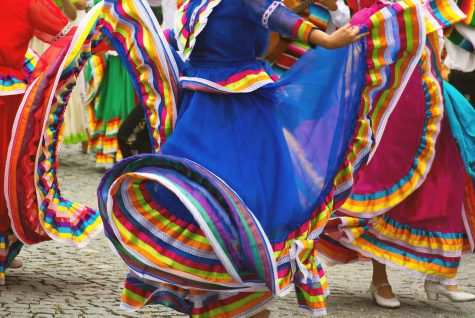 Hispanic dancers in colorful dresses! this is very normal in Hispanic cultures!