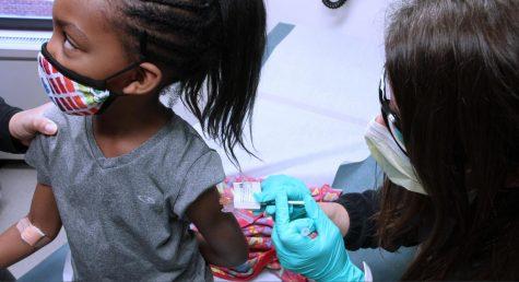 A child getting the COVID-19 vaccine.